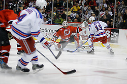 Feb 20, 2007; East Rutherford, NJ, USA; New Jersey Devils goalie Martin Brodeur (30) makes a save on New York Rangers center Blair Betts (19) during the third period at Continental Airlines Arena in East Rutherford, NJ.