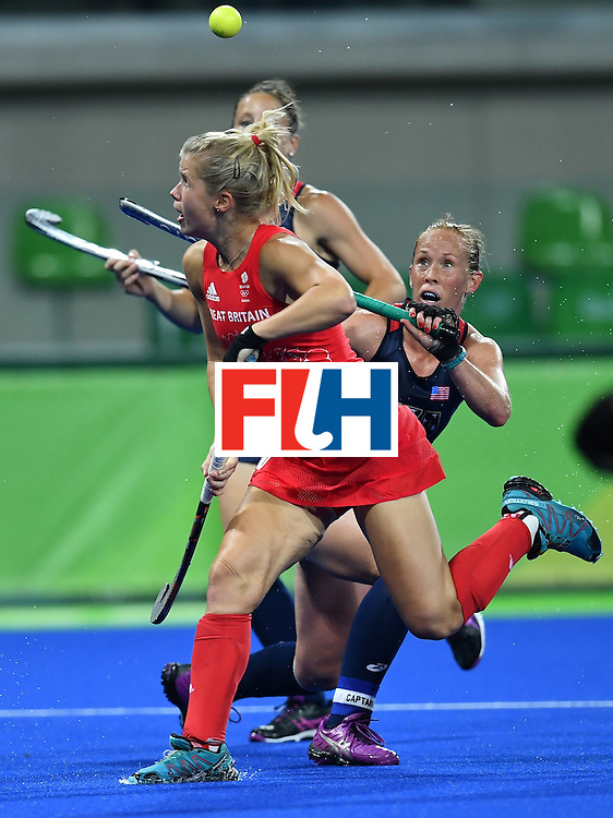 Great Britain's Sophie Bray and USA's Lauren Crandall (R) vie during the women's field hockey Britain vs the USA match of the Rio 2016 Olympics Games at the Olympic Hockey Centre in Rio de Janeiro on August, 13 2016. / AFP / MANAN VATSYAYANA        (Photo credit should read MANAN VATSYAYANA/AFP/Getty Images)