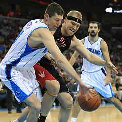06 February 2009: New Orleans Hornets forward Ryan Bowen (40) and Toronto Raptors center Jake Voskuhl (77) scramble for a loose ball during a NBA game between the New Orleans Hornets and the Toronto Raptors at the New Orleans Arena in New Orleans, LA.
