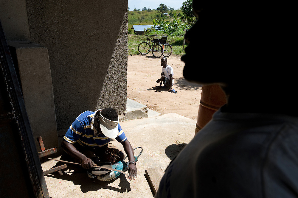 Mono (18) stepped on a landmine in 2007 and lost both legs. He now lives at Bogoro village with his sister Cadette and works making velos, wheelchair bikes for other disabled people.
