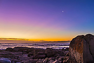 The waxing crescent Moon in the colours of an evening twilight at Cape Conran, Gippsland Coast, Victoria, Australia, March 31, 2017. From West Cape and Salmon Rocks. <br /> <br /> The Moon is turned upside down compared to a northern hemisphere view, and looks like a morning waning Moon for northeners. Pink crepuscular rays diverge from the sunset point. <br /> <br /> This is a single frame from a 700-frame time-lapse sequence with the 35mm lens and Canon 6D on Auto Exposure.