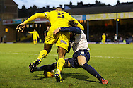 Ben Coker of Southend United (right) tackles Curtis Nelson of Plymouth Argyle during the Sky Bet League 2 match at Roots Hall, Southend<br /> Picture by David Horn/Focus Images Ltd +44 7545 970036<br /> 10/01/2015