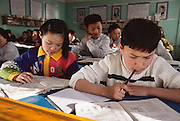 Batbileg Batsuuri, 12, puzzles over a lesson in Russian language class, Ulaanbaatar, Mongolia. From coverage of revisit to Material World Project family in Mongolia, 2001. .