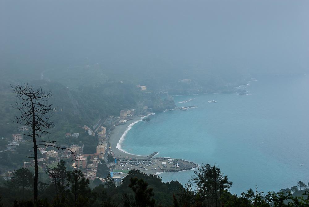 Fog hovers over Monterosso al MAre, Italy.