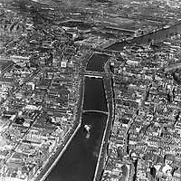 A175 Dublin City Centre.    (Part of the Independent Newspapers Ireland/NLI collection.)<br /> <br /> <br /> These aerial views of Ireland from the Morgan Collection were taken during the mid-1950's, comprising medium and low altitude black-and-white birds-eye views of places and events, many of which were commissioned by clients. From 1951 to 1958 a different aerial picture was published each Friday in the Irish Independent in a series called, 'Views from the Air'.<br /> The photographer was Alexander 'Monkey' Campbell Morgan (1919-1958). Born in London and part of the Royal Artillery Air Corps, on leaving the army he started Aerophotos in Ireland. He was killed when, on business, his plane crashed flying from Shannon.