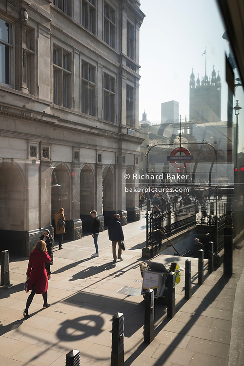 A view from a London bus of an entrance of Westminster Underground Station at the corner of Parliament Square, on 27th February 2019, in London, England.
