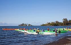 Caoe club time on Hilo Bay.