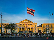 15 OCTOBER 2016 - BANGKOK, THAILAND:  The Thai flag flying at half staff for the late Bhumibol Adulyadej, the King of Thailand, in front of the Ministry of Defense in Bangkok. King Bhumibol Adulyadej died Oct. 13, 2016. He was 88. His death comes after a period of failing health. With the king's death, the world's longest-reigning monarch is Queen Elizabeth II, who ascended to the British throne in 1952. Bhumibol Adulyadej, was born in Cambridge, MA, on 5 December 1927. He was the ninth monarch of Thailand from the Chakri Dynasty and is known as Rama IX. He became King on June 9, 1946 and served as King of Thailand for 70 years, 126 days. He was, at the time of his death, the world's longest-serving head of state and the longest-reigning monarch in Thai history.     PHOTO BY JACK KURTZ