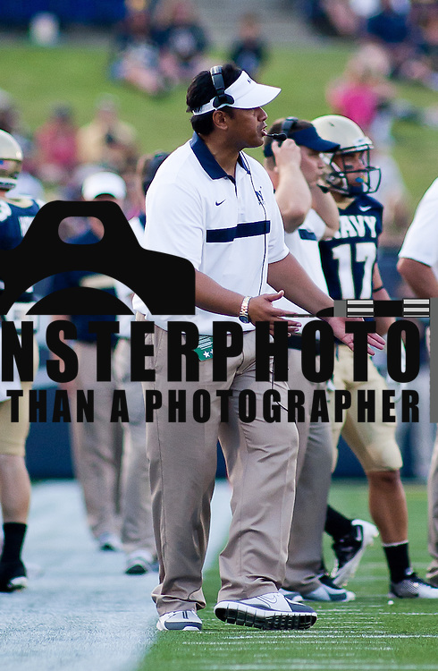 Navy Head Coach Ken Niumatalolo watches the play from the sidelines Saturday Sept. 3, 2011 at Marine Corps Memorial Stadium in Annapolis Maryland.<br /> <br /> Navy would go on to defeat Delaware 40-17 Navy leads the all-time series against the Blue Hens, 9-7, including a 35-18 victory in 2009 when quarterback Ricky Dobbs rushed for five touchdowns. <br /> <br /> Navy will hit road for a show down with Western Kentucky next Saturday Sept. 10, 2011 in Bowling Green, Ky.