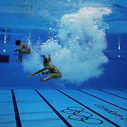 Pandelela Rinong Pamg and Jun Hoong Cheong, Malaysia, return to the surface after their dive during the Women's Synchronised 3m springboard diving competition at the Aquatic Centre at Olympic Park, Stratford during the London 2012 Olympic games. London, UK. 29th July 2012. Photo Tim Clayton