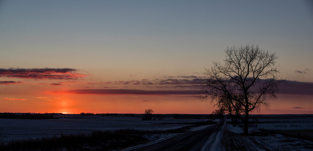 The sun sets on Lincoln Road in south central North Dakota on Tuesday, Jan. 20, 2018.
