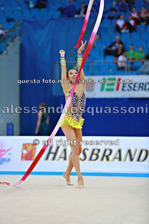 Zeng Laura  during qualifying at ribbon in Pesaro World Cup 02 April 2016. Laura was born in Hartford, Connecticut in October 14, 1999. She is an American individual rhythmic gymnast.