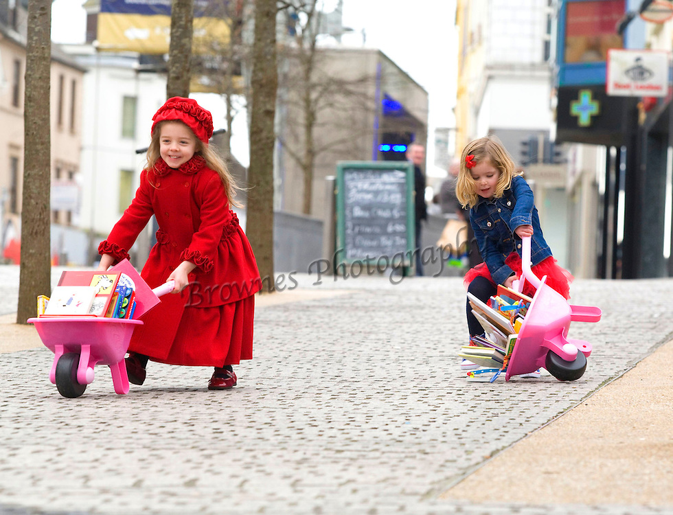 FREE TO USE IMAGE. 28/2/2012. News. Waterford Writers Weekend, World Book Day. Getting ready for Waterford Writers Weekend, March 23rd to 25th are Rosie Flynn 3yrs and Lucia Whelan 5yrs pictured at John Roberts Square, Waterford City stocking up on some books. Photo Patrick Browne