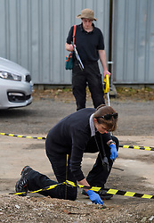 © Licensed to London News Pictures. 16/05/2017. London, UK. A police search team carry out detailed mapping of the area to be searched, at the scene where police continue to search for the body of murdered schoolgirl Danielle Jones at a block of garages in Stifford Clays in Thurrock, Essex. The 15-year-old was last seen on Monday June 18 2001 at about 8am when she left her home in East Tilbury to catch the bus to school.  Photo credit: Ben Cawthra/LNP