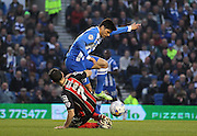 Brighton's Joao Teixeira evades a tackle from AFC Bournemouth midfielder Marc Pugh during the Sky Bet Championship match between Brighton and Hove Albion and Bournemouth at the American Express Community Stadium, Brighton and Hove, England on 10 April 2015. Photo by Phil Duncan.