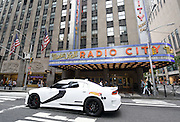 A Hot Wheels Star Wars First Order Stormtrooper Dodge vehicle, modeled after the new Hot Wheels line of Star Wars character cars, drives through New York, Friday, Sept. 4, 2015, to celebrate Force Friday.  (Photo by Diane Bondareff/Invision for Mattel/AP Images)