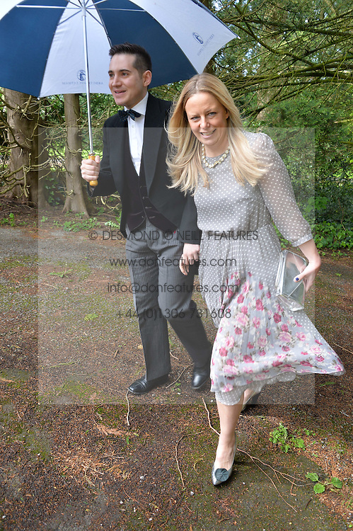RICHARD DENNEN and ASTRID HARBORD at the wedding of Princess Florence von Preussen second daughter of Prince Nicholas von Preussen to the Hon.James Tollemache youngest son of the 5th Lord Tollemache held at the Church of St.Michael & All Angels, East Coker, Somerset on 10th May 2014.