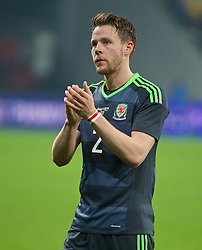 KIEV, UKRAINE - Easter Monday, March 28, 2016: Wales' Chris Gunter applauds the travelling supporters after the 1-0 defeat to Ukraine during the International Friendly match at the NSK Olimpiyskyi Stadium. (Pic by David Rawcliffe/Propaganda)