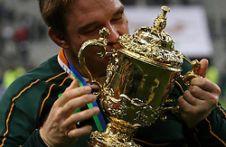 South Africa's John Smit kisses the trophy following victory in the IRB Rugby World Cup Final match at Stade de France, Saint Denis, France.