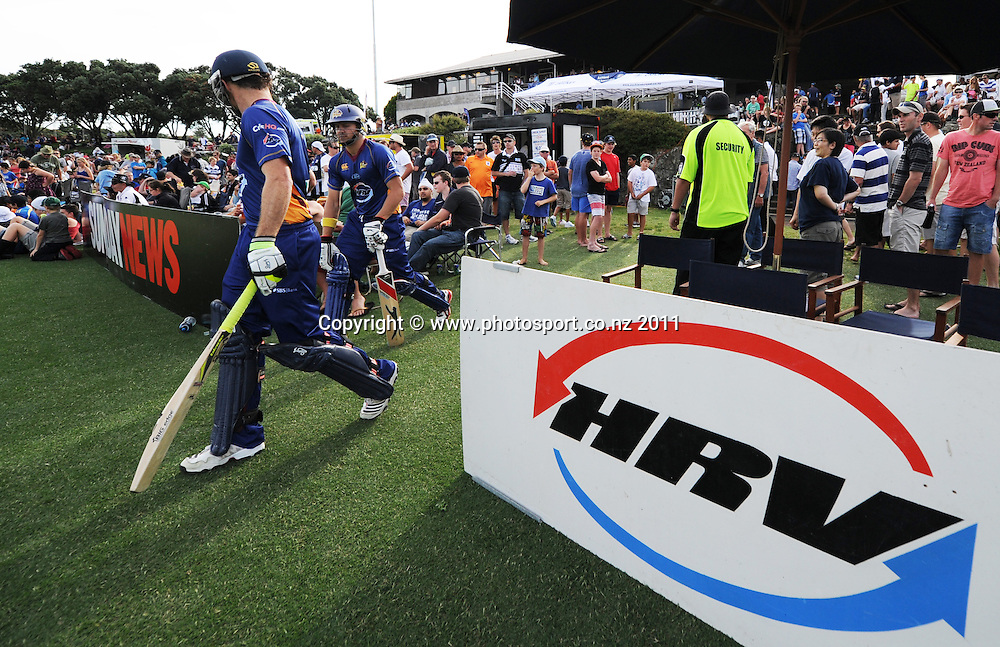 Otago batsman enter the field at the HRV Twenty20 Cricket match between the Auckland Aces and Otago Volts at Colin Maiden Oval in Auckland, New Zealand on Friday 6 January 2012. Photo: Andrew Cornaga/Photosport.co.nz