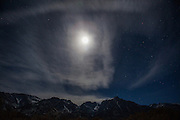 A bright moon shines over the eastern Sierra Nevada mountains.