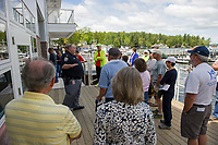 Captain Tim Dunleavy gives visitors a tour of the NH Dept of Safety Marine Patrol headquarters during their open house on Saturday morning.  (Karen Bobotas/for the Laconia Daily Sun)
