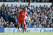 Liverpool defender Nathaniel Clyne and Everton defender Ramiro Funes Mori tussle during the Barclays Premier League match between Everton and Liverpool at Goodison Park, Liverpool, England on 4 October 2015. Photo by Alan Franklin.