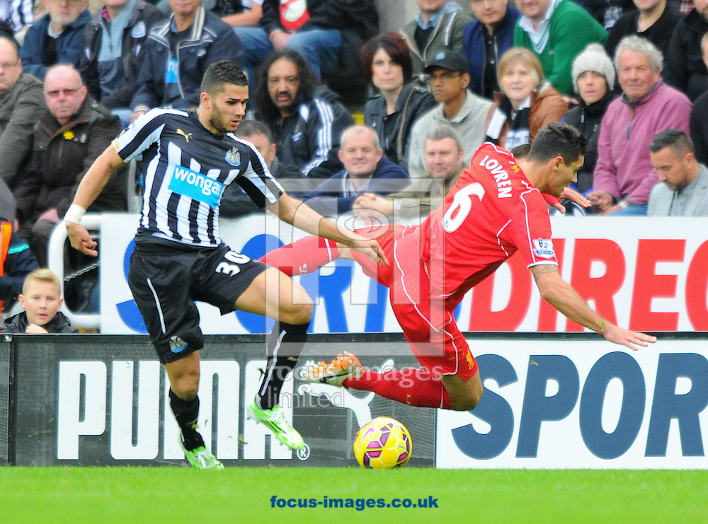Mehdi Abeid of Newcastle United (left) tackles Dejan Lovren of Liverpool during the Barclays Premier League match at St. James's Park, Newcastle<br /> Picture by Greg Kwasnik/Focus Images Ltd +44 7902 021456<br /> 01/11/2014