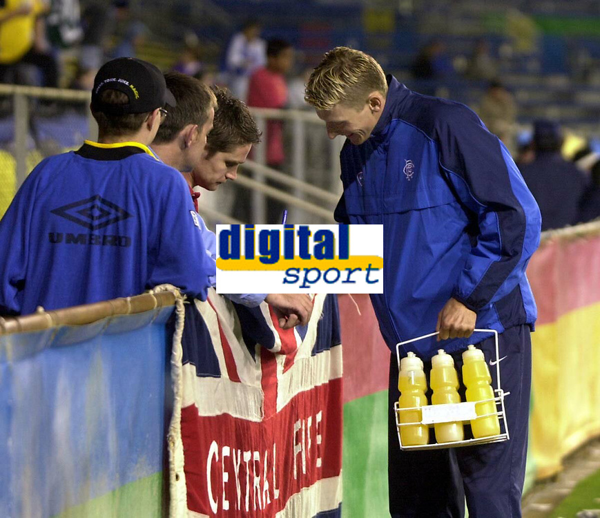 Rangers v Miami Fusion friendly match, Fort Lauderdale, Florida.<br /><br />Pic Ian Stewart,  Saturday January 20th, 2001.<br /><br />Tore Andre Flo signs autographs for travelling fans as he carries  drinks bottle to bench before start of 2nd half