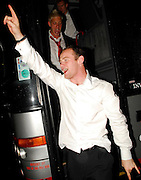 09.MAY.2007. LONDON<br /> <br /> MAN UTD PLAYERS AND MANAGER ALEX FURGERSON CELEBRATE WINNING THE PREEMIERSHIP TROPHY BY GOING TO THE MILL RESTURANT/CASINO ON PARK LANE AND LEAVE ALL LOOKING QUITE DRUNK, PLAYERS INCLUDED RIO FERDINAND, RONALDO, WAYNE ROONEY WHO HAD BLOOD ON HIS LIP AND SWUNG FROM THE COACH SINGING SONGS , RYAN GIGGS, PAUL SCHOLES,WES BROWN, EDWIN VAN DERSAR, JOHN O,SHEA ALAN SMITH, KIERON RICHARDSON, GABRIEL HEINZE, THOMAS KUSACK WITH A BLACK EYE,  GARY NEVILLE, PATRICE EVRA, DARREN FLETCHER, NEMANJA VIDIC CHRIS EAGLES CHAIRMAN DAVID GILL AND BOOBY ROBSON.<br /> <br /> BYLINE: EDBIMAGEARCHIVE.CO.UK<br /> <br /> *THIS IMAGE IS STRICTLY FOR UK NEWSPAPERS AND MAGAZINES ONLY*<br /> *FOR WORLD WIDE SALES AND WEB USE PLEASE CONTACT EDBIMAGEARCHIVE - 0208 954 5968*
