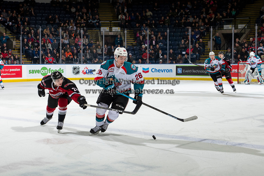 KELOWNA, CANADA - JANUARY 26:  Yannik Valenti #20 of the Vancouver Giants stick checks Liam Kindree #26 of the Kelowna Rockets during first period on January 26, 2019 at Prospera Place in Kelowna, British Columbia, Canada.  (Photo by Marissa Baecker/Shoot the Breeze)