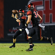 15 September 2018: San Diego State Aztecs quarterback Ryan Agnew (9) rolls out of the pocket as he passes the ball to fullback Isaac Lessard (34)  in the third quarter. The Aztecs beat the Sun Devils 28-21 at SDCCU Stadium in San Diego, California.