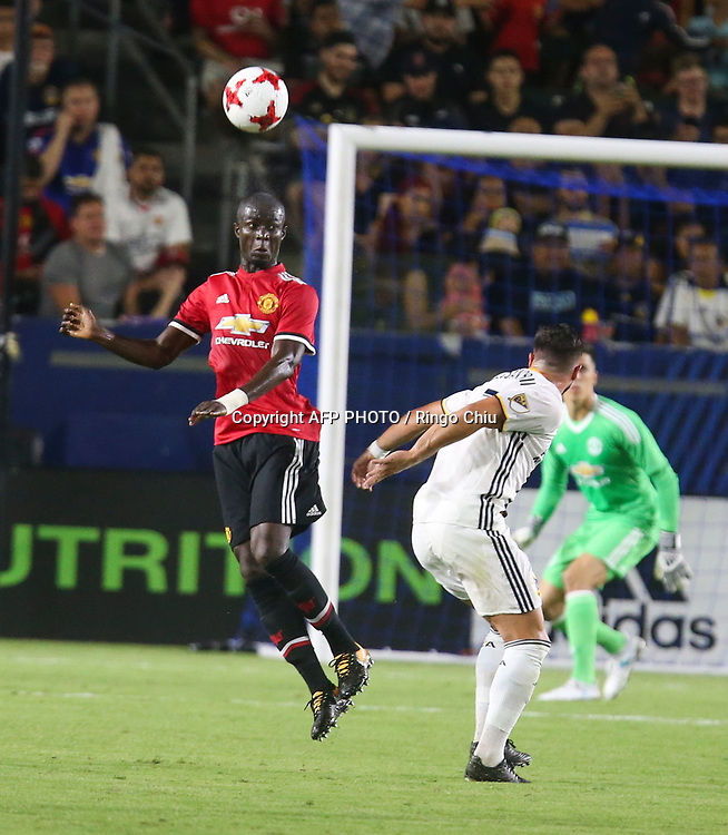 Manchester United Eric Bailly, left, heads the ball against Los Angeles Galaxy  during the second half of a national friendly soccer game at StubHub Center on July 15, 2017 in Carson, California. The Manchester United won 5-2. AFP PHOTO / Ringo Chiu
