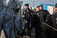 Calais, Pas-de-Calais, France - 25.10.2016    <br />  <br /> Beginn of the camp destruction on the 2nd day of the eviction on the so called &rdquo;Jungle&quot; refugee camp on the outskirts of the French city of Calais. Many thousands of migrants and refugees are waiting in some cases for years in the port city in the hope of being able to cross the English Channel to Britain. French authorities announced a week ago that they will evict the camp where currently up to up to 10,000 people live.<br /> <br /> Beginn des Camp Abrisses am zweiten Tag der Raeumung des so genannte &rdquo;Jungle&rdquo;-Fluechtlingscamp in der franz&ouml;sischen Hafenstadt Calais. Viele tausend Migranten und Fluechtlinge harren teilweise seit Jahren in der Hafenstadt aus in der Hoffnung den Aermelkanal nach Gro&szlig;britannien ueberqueren zu koennen. Die franzoesischen Behoerden kuendigten vor einigen Wochen an, dass sie das Camp, indem derzeit bis zu bis zu 10.000 Menschen leben raeumen werden. <br /> <br /> Photo: Bjoern Kietzmann