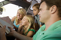 Family in RV Looking at Road Map