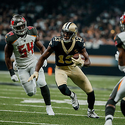 Sep 9, 2018; New Orleans, LA, USA; New Orleans Saints wide receiver Michael Thomas (13) runs past Tampa Bay Buccaneers linebacker Lavonte David (54) during the first quarter of a game at the Mercedes-Benz Superdome. Mandatory Credit: Derick E. Hingle-USA TODAY Sports
