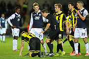 Burton Albion defender Tom Flanagan on the ground following a hard tackle from Millwall FC midfielder George Saville during the Sky Bet League 1 match between Burton Albion and Millwall at the Pirelli Stadium, Burton upon Trent, England on 1 December 2015. Photo by Aaron Lupton.
