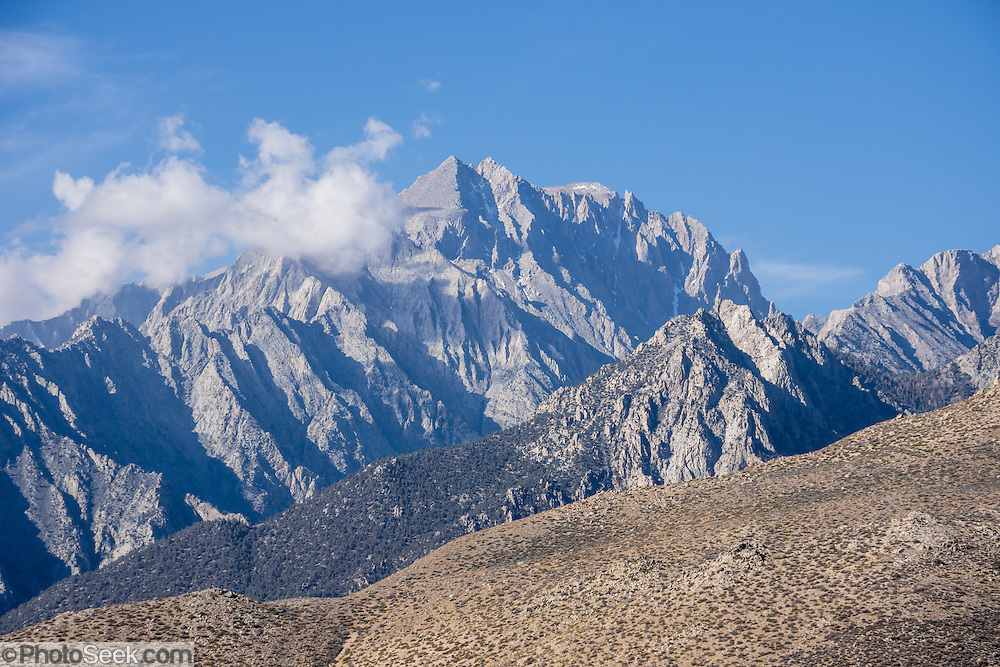 Mount Williamson (14,375 feet) is the 6th highest peak in the contiguous United States and rises in John Muir Wilderness in the Sierra Nevada dramatically 10,000 feet above Owens Valley (near Manzanar National Historic Site). Photographed in Inyo National Forest, at the corner of dirt Foothill Road and paved Onion Valley Road, west of Independence, California, USA.
