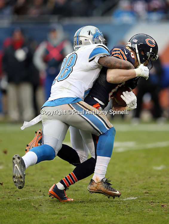 Chicago Bears wide receiver Marc Mariani (80) gets tackled by Detroit Lions rookie cornerback Quandre Diggs (28) as he catches a fourth quarter pass for a first down during the NFL week 17 regular season football game against the Detroit Lions on Sunday, Jan. 3, 2016 in Chicago. The Lions won the game 24-20. (©Paul Anthony Spinelli)