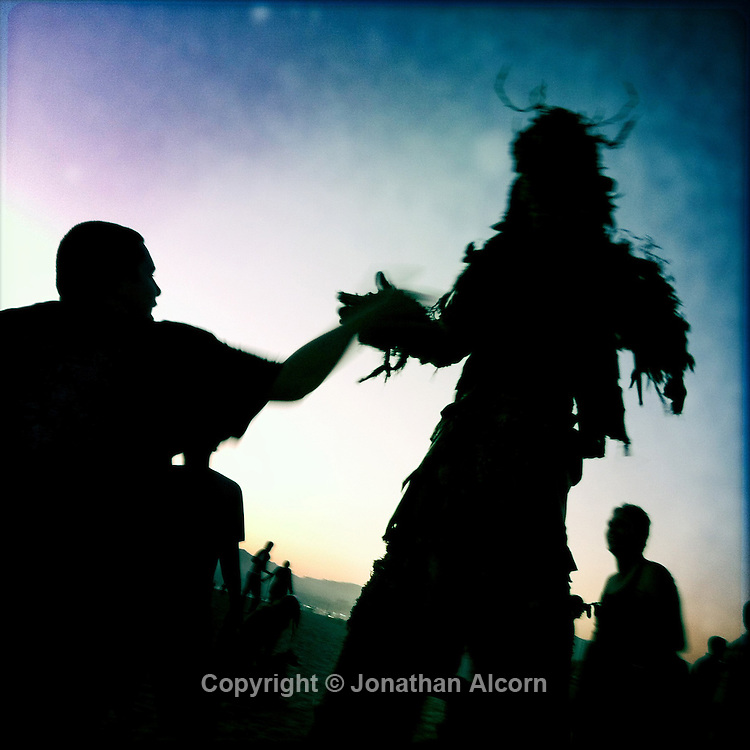 Tree man at the Venice Beach drum circle in California