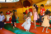 Israel, Netanya, Outdoor, Summer entertainment for children. Children play in a jump house