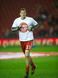 LIVERPOOL, ENGLAND - Tuesday, March 13, 2012: Liverpool's Jamie Carragher warms-up with a Sport Relief t-shirt before the Premiership match against Everton at Anfield. (Pic by David Rawcliffe/Propaganda)