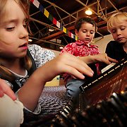 9/23/08 -- BATH, Maine. Lydia Merrill, 5 of Bath, figures out the Autoharp as classmates Syd Pols, 3 and Cooper Eden-Day, 5, right, wait their turn at Bath Dance Works Preschool Music program on Tuesday morning. FMI call 522-3900 or email: sharonmusic@gwi.net. Photo by Roger S. Duncan.