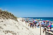 Crowded summer beach with colorful umbrellas, Nauset Beach, Cape Cod National Seashore, Cape Cod, Massachusetts, USA