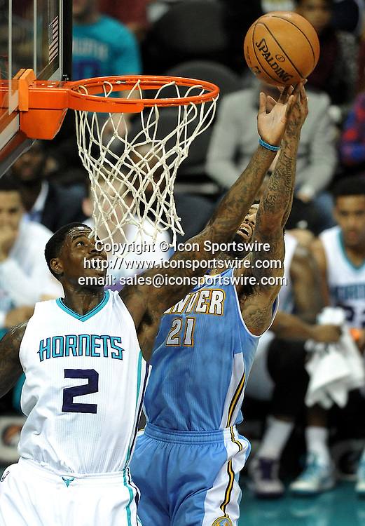 Dec. 22, 2014 - Charlotte, NC, USA - Charlotte Hornets forward Marvin Williams (2) fights for control of a loose ball with Denver Nuggets forward Wilson Chandler (21) during first half action on Monday, Dec. 22, 2014, at Time Warner Cable Arena in Charlotte, N.C