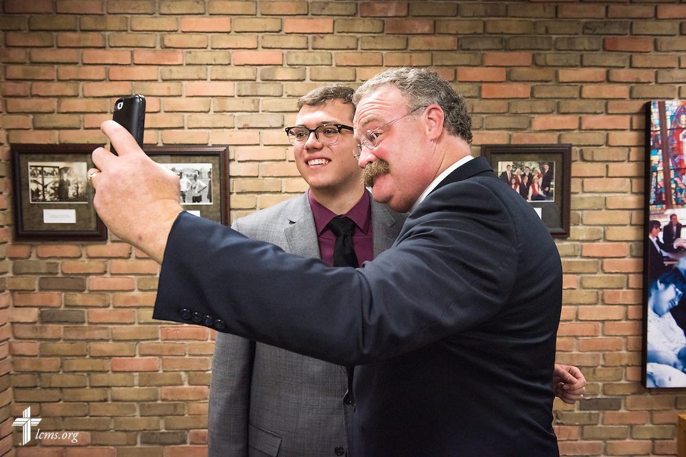The Rev. Dr. Matthew C. Harrison, president of The Lutheran Church–Missouri Synod, joins Mason Vieth for a 'selfie' as he meets with Pre-Seminary Program students during a brief meeting on the university campus in River Forest, Ill., on Sunday, Oct. 12, 2014. LCMS Communications/Erik M. Lunsford