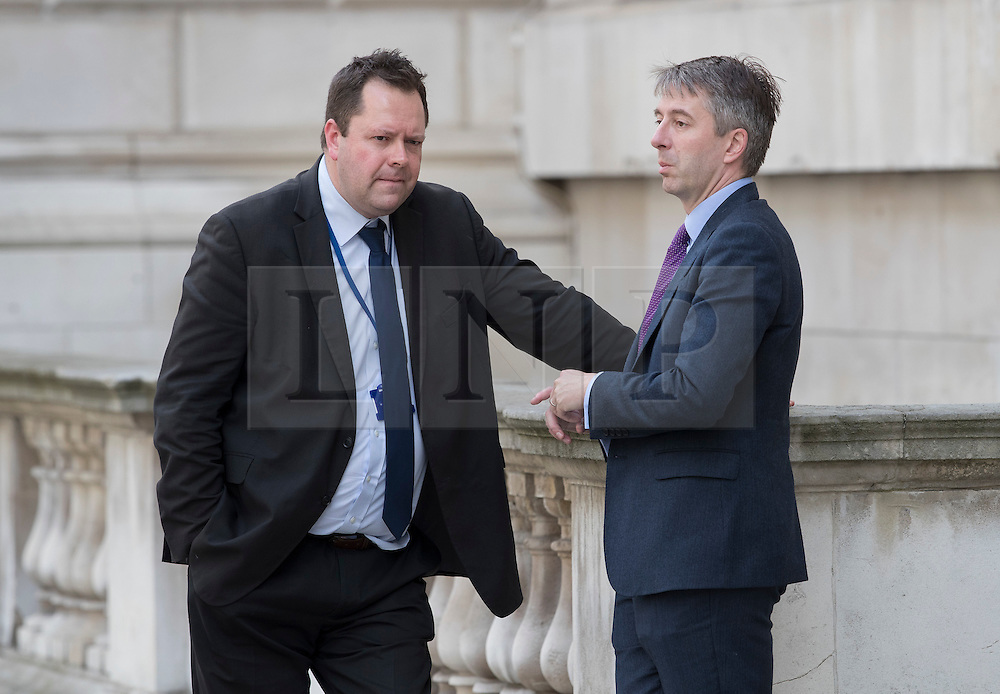 © Licensed to London News Pictures. 14/07/2016. London, UK. Will Walden (L) and Joey Jones, aids to Prime Minister Theresa May and Foreign Secretary Boris Johnson talk in Whitehall as Prime Minister Theresa May continues to make cabinet appointments on her first full day in office. Photo credit: Peter Macdiarmid/LNP