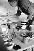 Mo painting signs, Glastonbury, Somerset, 1989