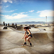 A woman navigates the swells and hollows of Venice Beach Skate Park on a sunny November day. John Boal Photography