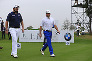 Shane Lowry (IRL) and Graeme McDowell (NIR) walk off the 2nd tee during Saturay's Round 3 of the 2014 BMW Masters held at Lake Malaren, Shanghai, China. 1st November 2014.<br /> Picture: Eoin Clarke www.golffile.ie